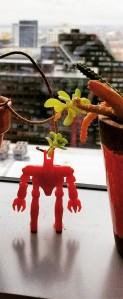 red robot hero pose at window