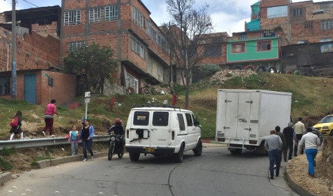 Dangerous hilly road with cars and pedestrians, Ciudad Bolivar, Bogota